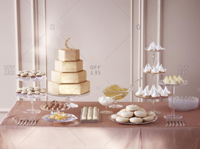 Dessert buffet with wedding cake