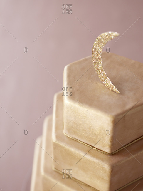 Close-up of layered cake with moon decoration