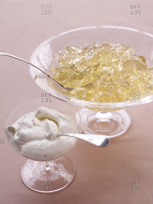 Yellow jelly and cream in glass bowl