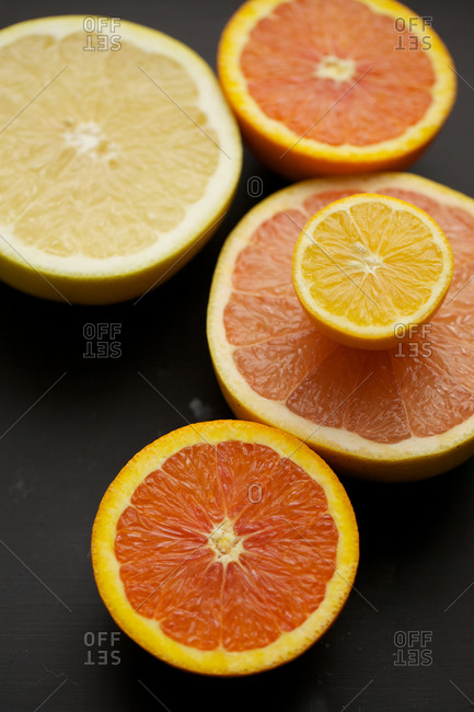 Top view of halved orange, grapefruit and lemon.