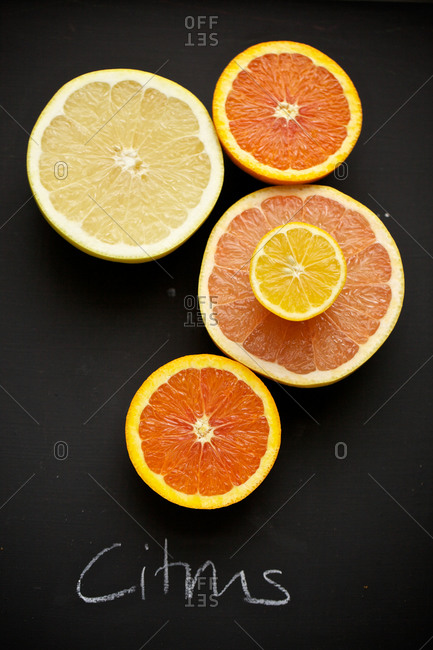 Top view of halved orange, grapefruit and lemon.