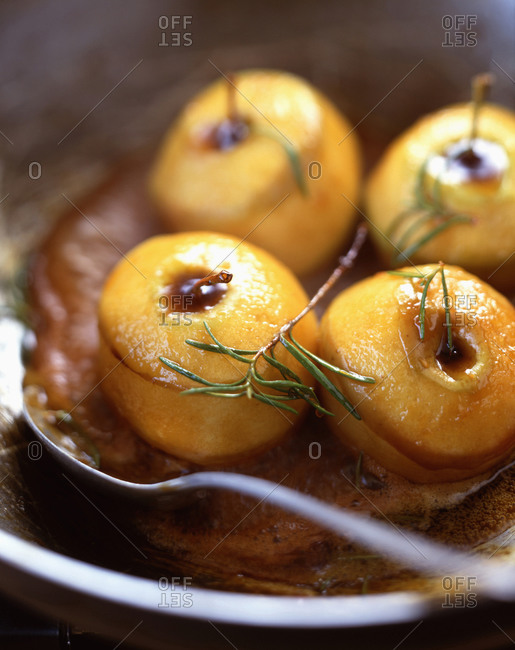 Rosemary baked apples in a bowl
