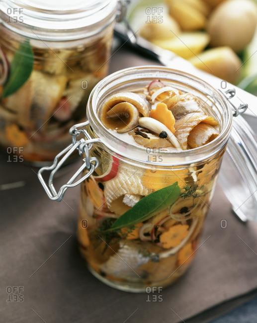 Fillets of herring in jar of oil