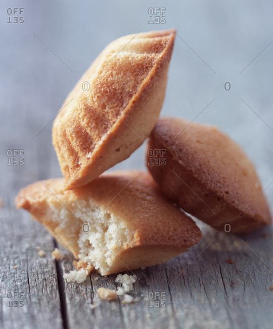 Financier almond sponge cakes on wooden table