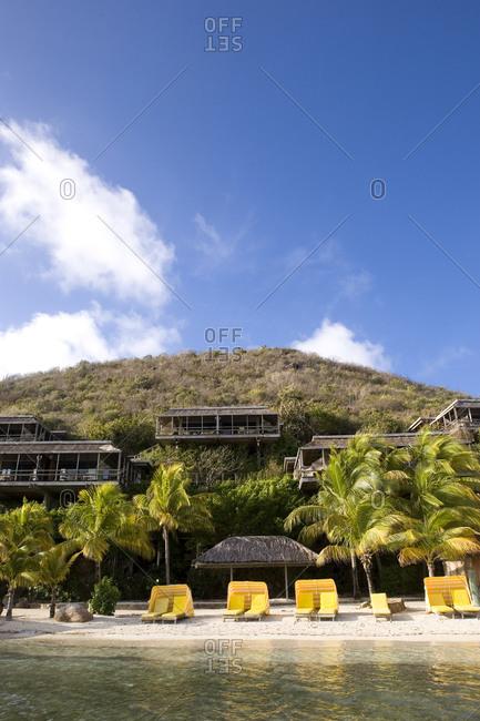 Breathtaking view of luxurious beachfront villas and sandy beach.
