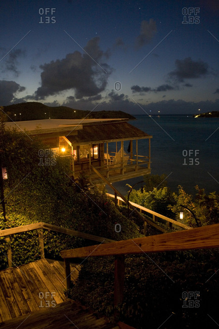 Night view of beachfront cottages and tranquil Atlantic Ocean.