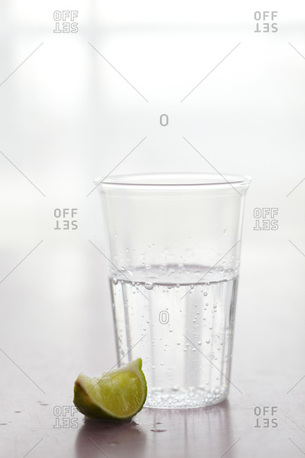 Sparkling water with lime wedge