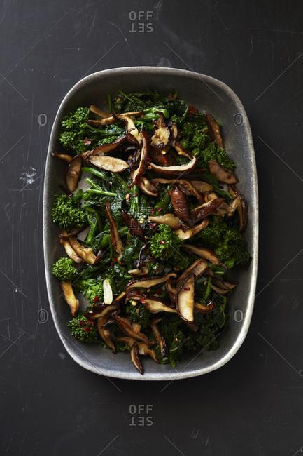 Top view of broccoli rabe and shiitakes