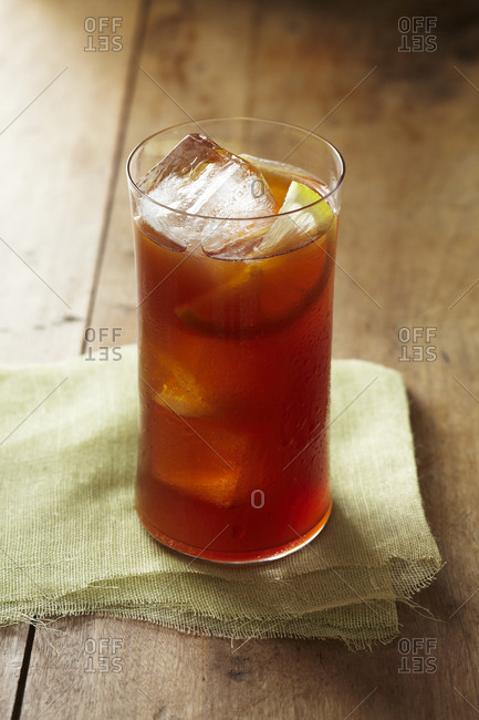 Dark and Stormy cocktail poured over ice