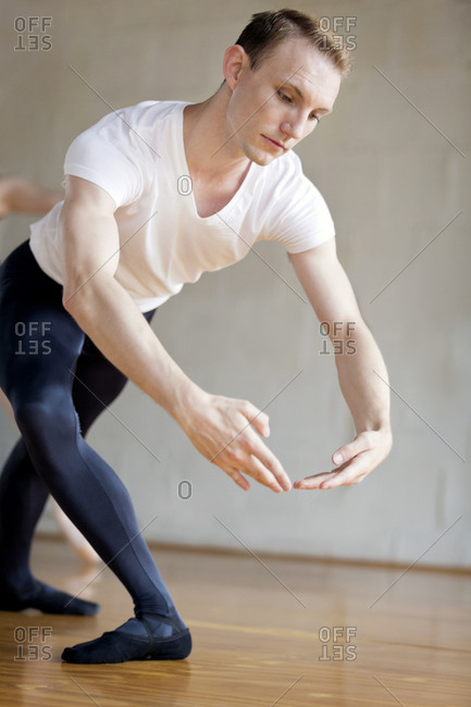Portrait of male ballet dancer practicing