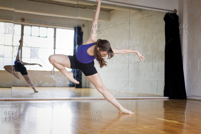 Modern dancer practicing in studio