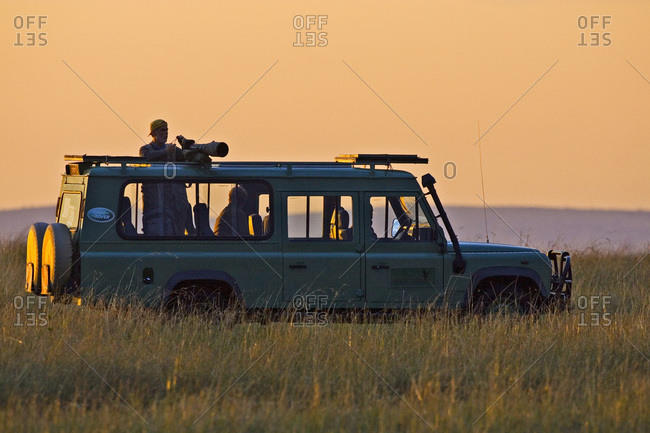 An early morning in the Maasai Mara Kenya,  as photographers looking on in their land vehicles