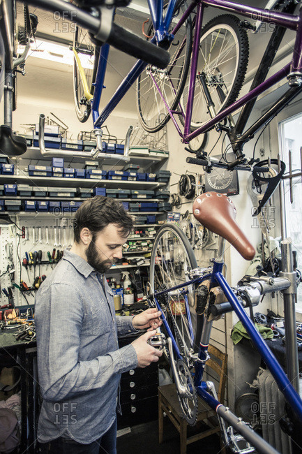 Repairman working at bicycle repair shop