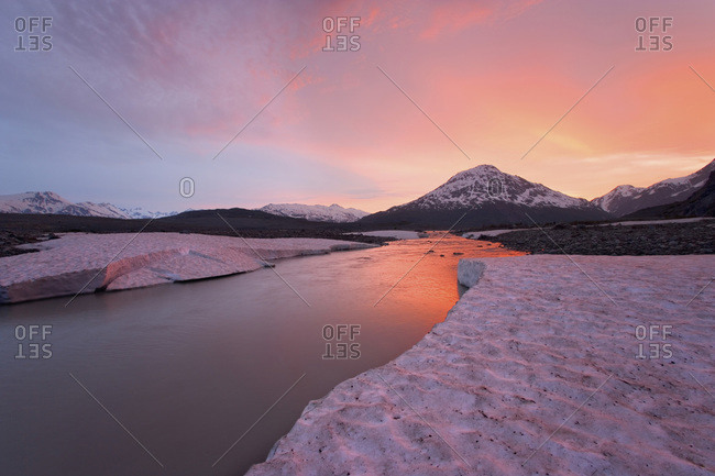 Canada, British Columbia, Alsek River Valley. View of Alsek River at sunset.