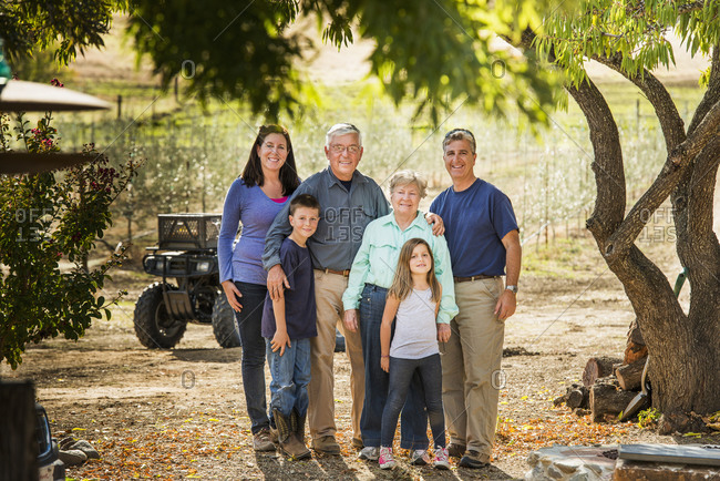 Family smiling in olive grove