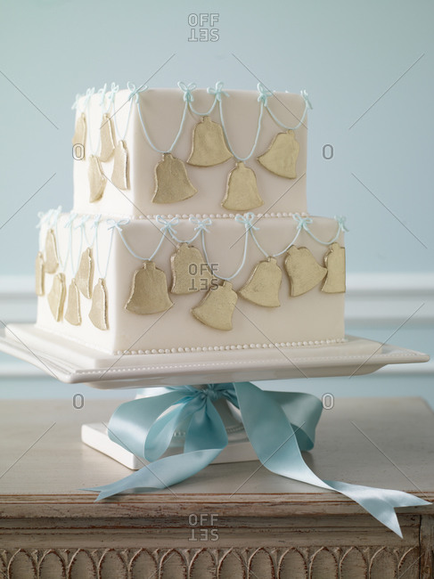 Two-tier fondant cake served on cake stand