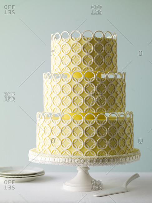 Three-layered wedding cake on a table