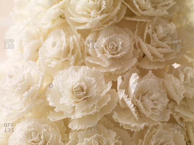 Close-up of edible white roses made of fondant