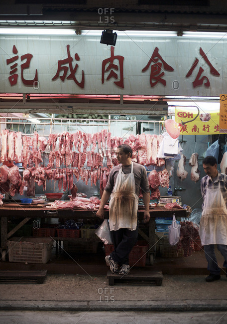 A butcher standing outside his shop in central Hong Kong