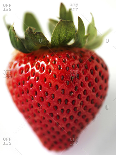 Close-up of a ripe strawberry on white background