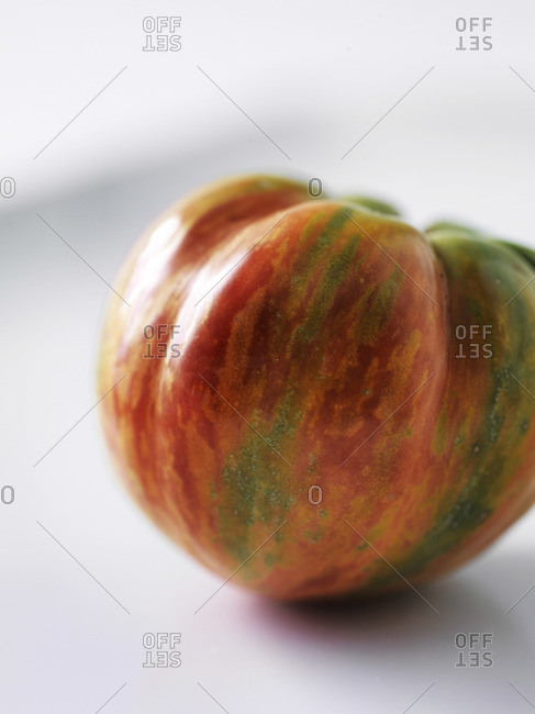 Heirloom tomato on white background