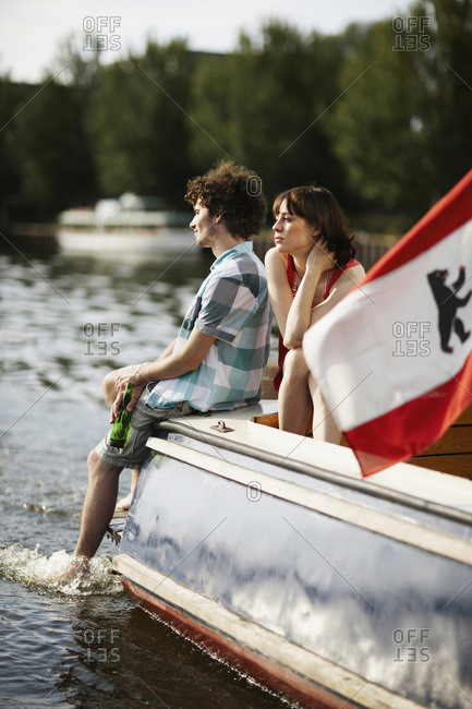 Young couple on motor boat, Berlin, Germany