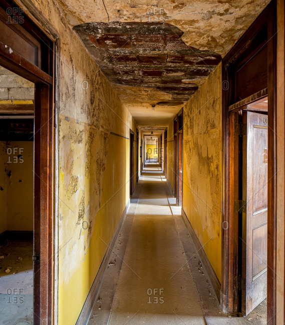 Abandoned corridor and crumbling walls.