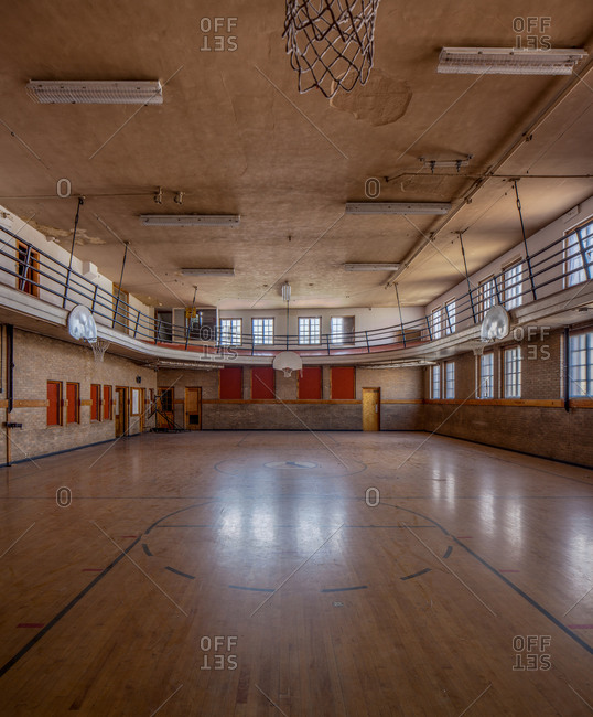 Abandoned gym with crumbling ceiling.
