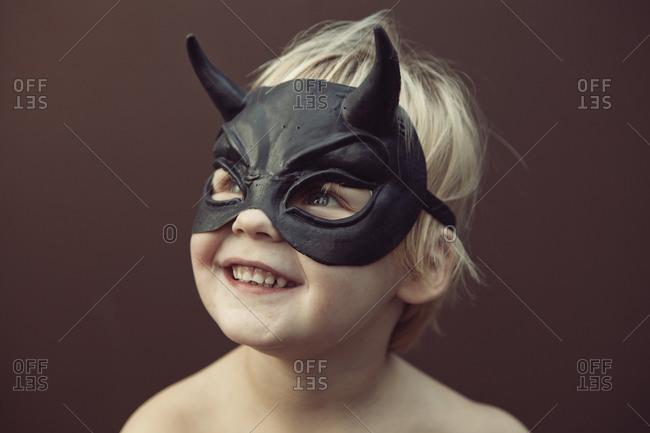 Caucasian boy wearing mask