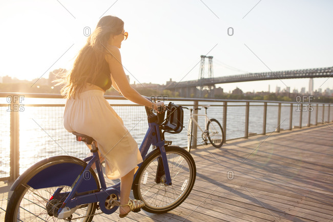 A young woman on a bike ride