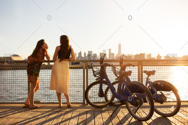 Two friends take a rest near the East River in Brooklyn