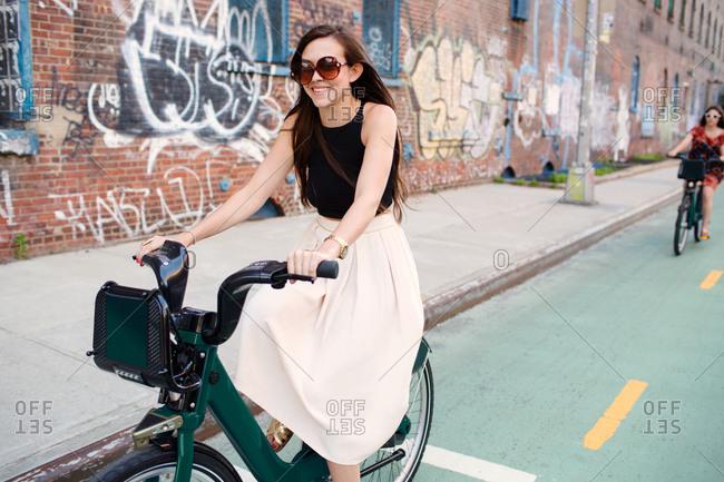 Two friends enjoy a bike ride together