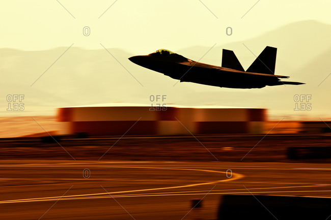 Silhouette of military jet, closeup.