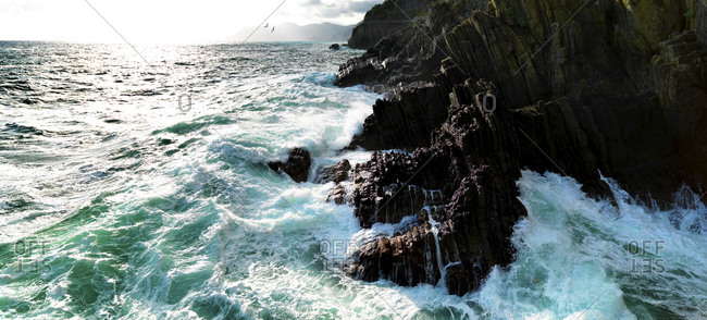 Waves crashing on the rocks.