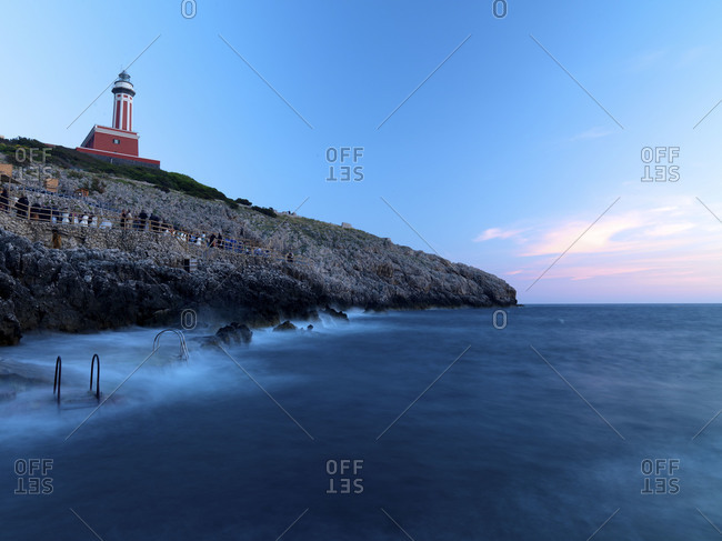 Picturesque lighthouse on top of cliff.
