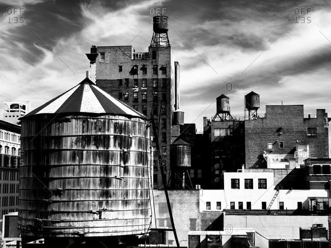 Old water tanks on the roof in New York City.