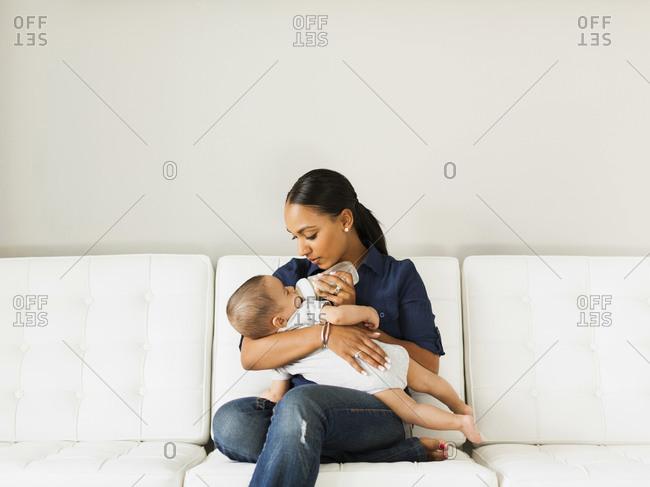 Mother feeding baby (2-5 moths)