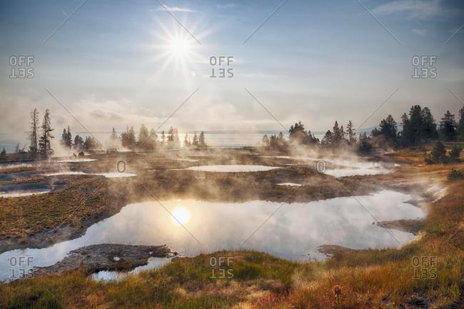 West Thumb Geyser Basin, Sun reflecting in water