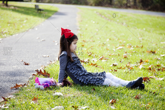 Young girl pouts on the grass