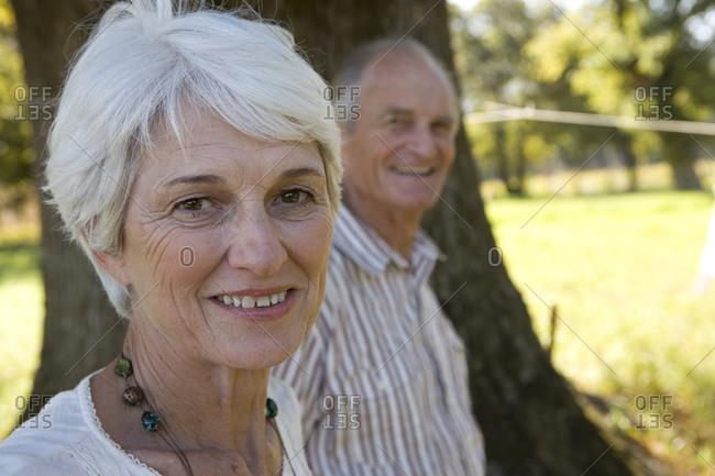 Portrait of senior couple smiling, close-up