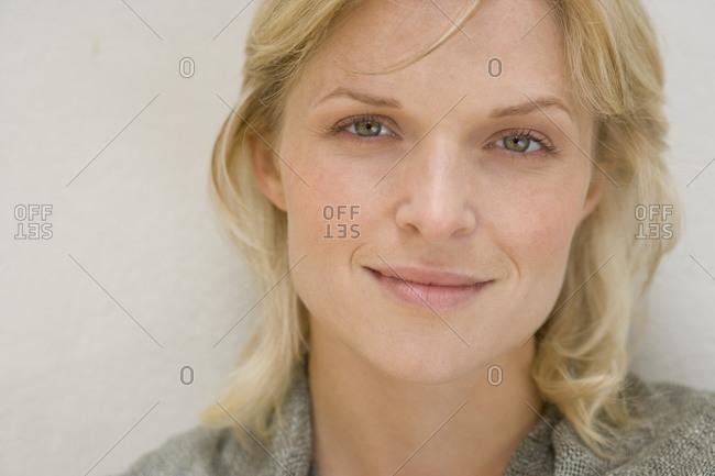 Portrait of woman smiling, close-up