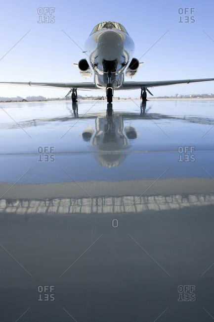 Aeroplane on runway, reflection on ground