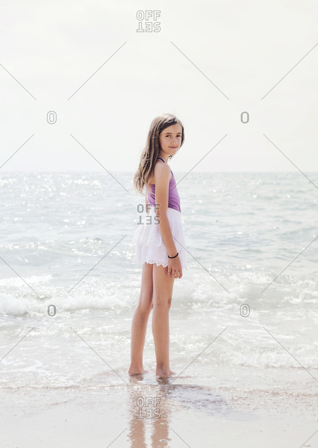 Portrait of young girl standing in shallow water