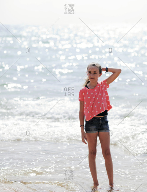 Portrait of girl standing in shallow water