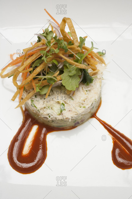 Coleslaw salad served with stylish topping and sauce