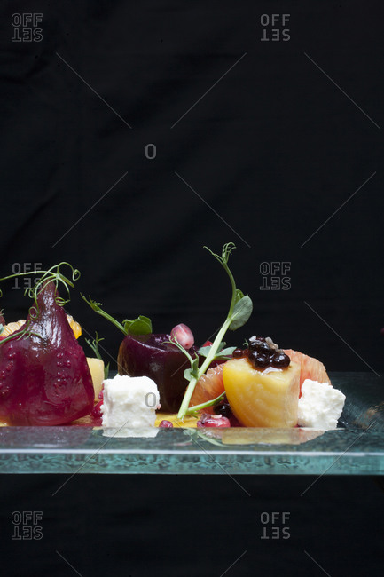 Assortment of fruits and vegetables served on dish