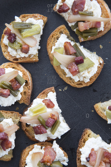 Bruschetta with ricotta cheese, ham and pickled vegetables