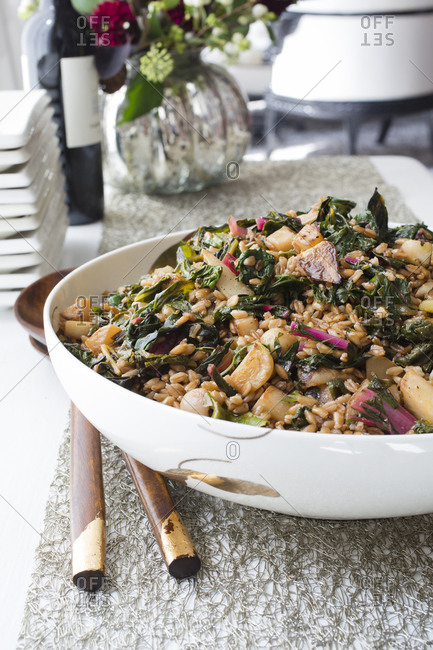 Warm Swiss chard and barley salad served in big bowl