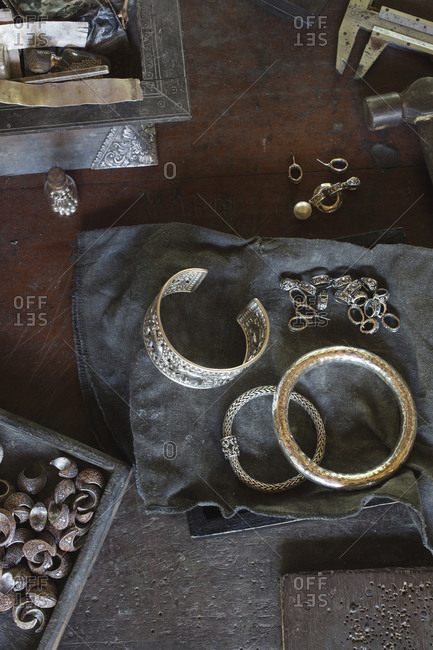 Overhead view of Thaibracelets and earrings on table