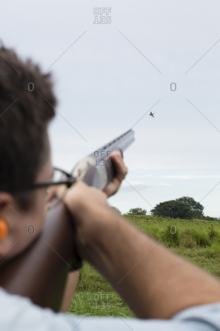 Rear view of man aiming the hunt
